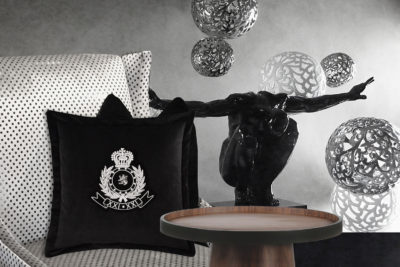 Decorative Old Club Throw Pillow on Chair.