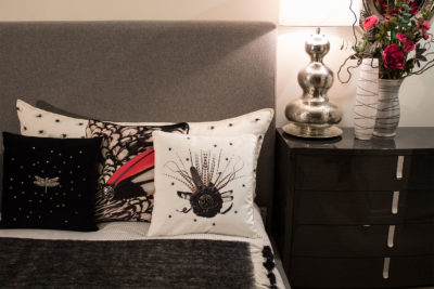 Decorative Feathers Throw Pillows on Bed.
