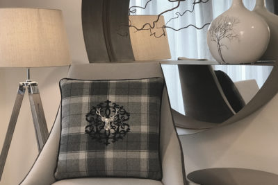 Tartan Cushions on Chair in Lounge.