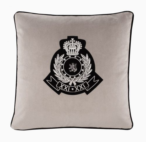 Medusa II cushion with heraldic crest.