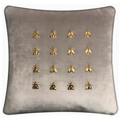 Throw pillow with 16 gold bees.