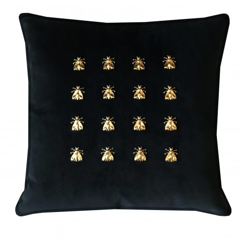 Black velvet throw pillow with 16 gold bees.