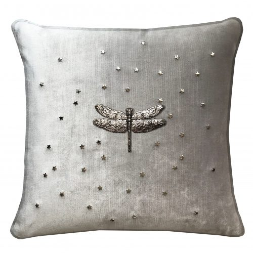 Throw pillow with silver dragonfly.