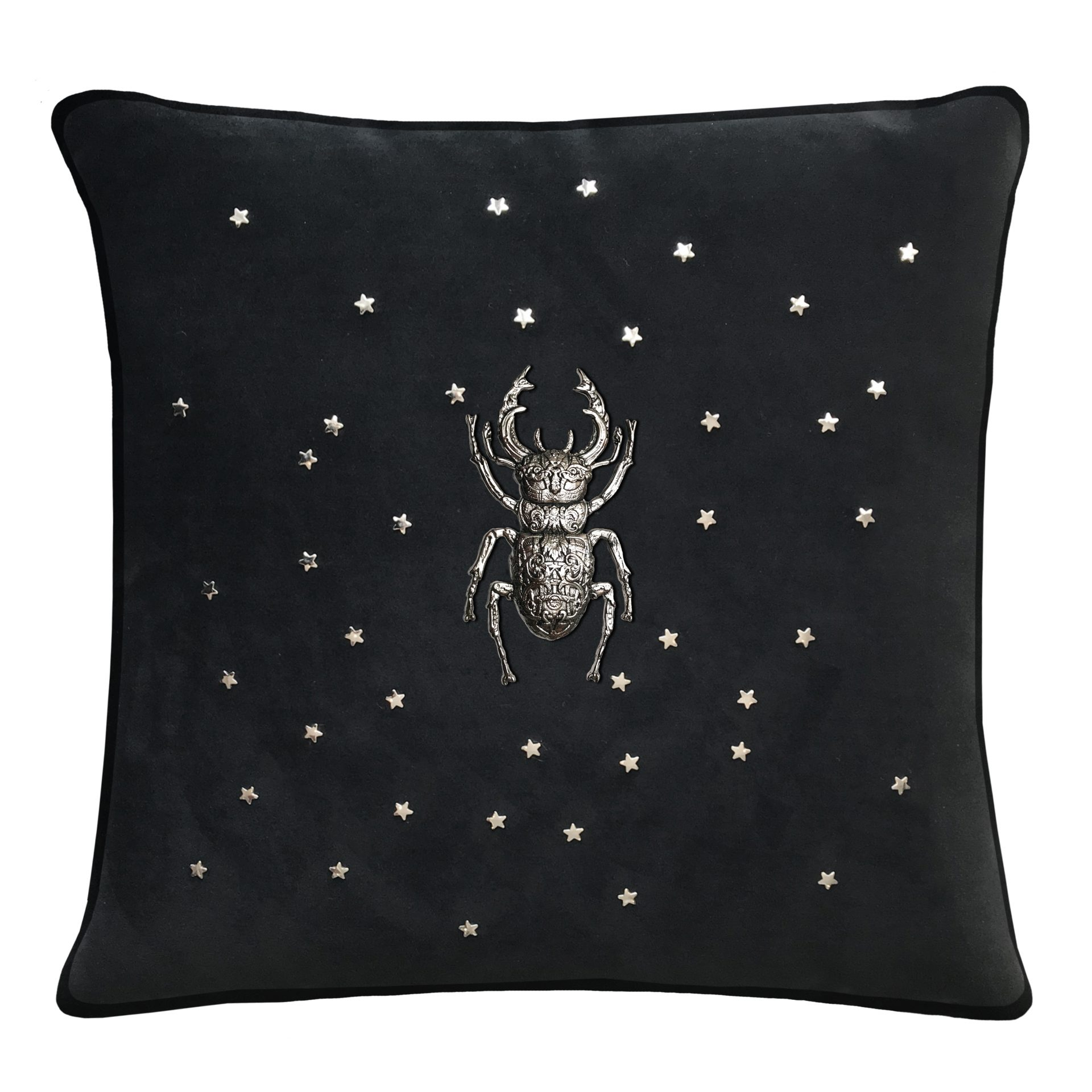 Black throw pillow with stag beetle and stars.