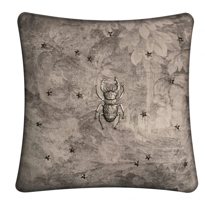 Silver stag beetle on linen throw pillow.