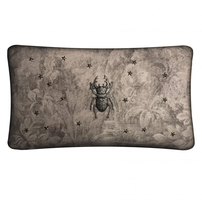 Linen throw pillow with metal stag beetle.