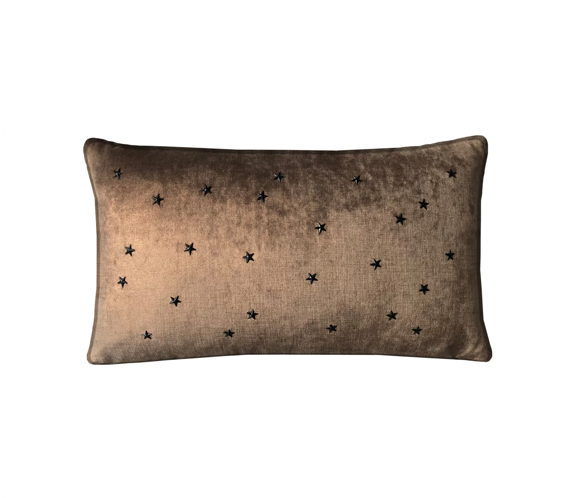 Copper throw pillow with black stars.