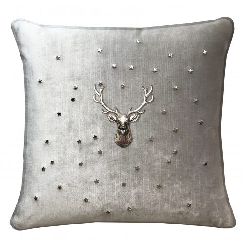 Velvet throw pillow with stag and stars.