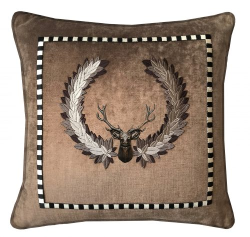 Copper throw pillow with embroidered detail and bronze stag.