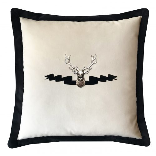 Velvet throw pillow with silver stag and velvet applique ribbon.