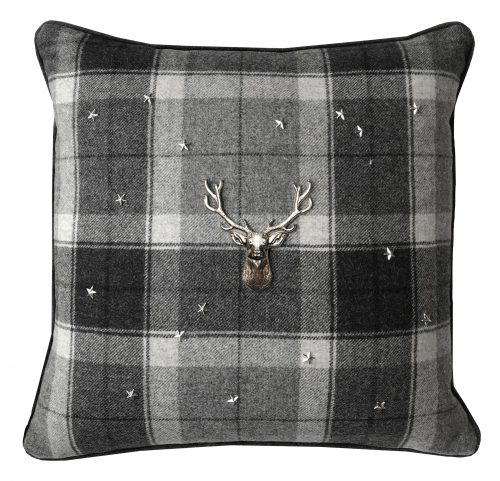 Grey tartan throw pillow with silver stag and stars.
