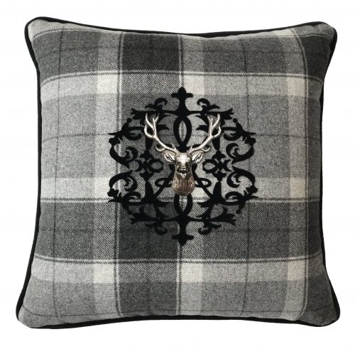 Tartan throw pillow with velvet applique monogram and silver stag.