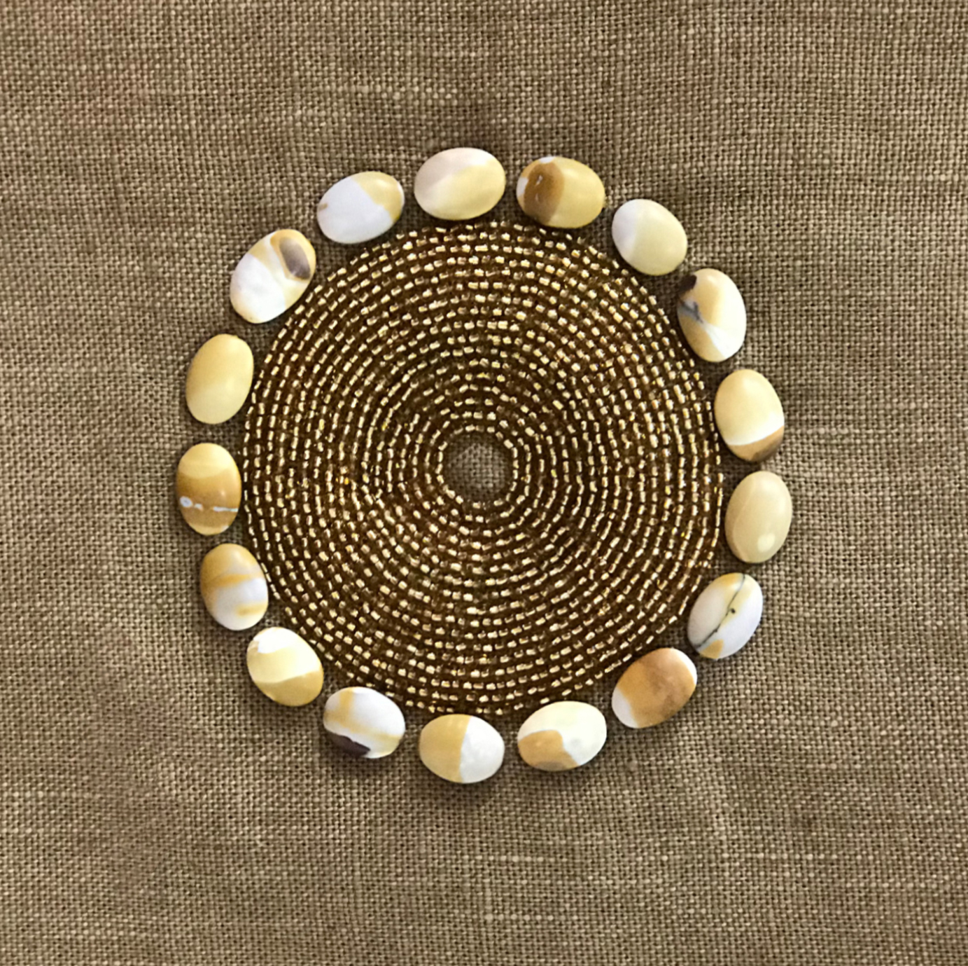 e3b8b41cf536 Hand-Dyed Linen Throw Pillow with African Beads and cowrie shells.
