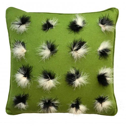 Avocado throw pillow with marabou feathers.