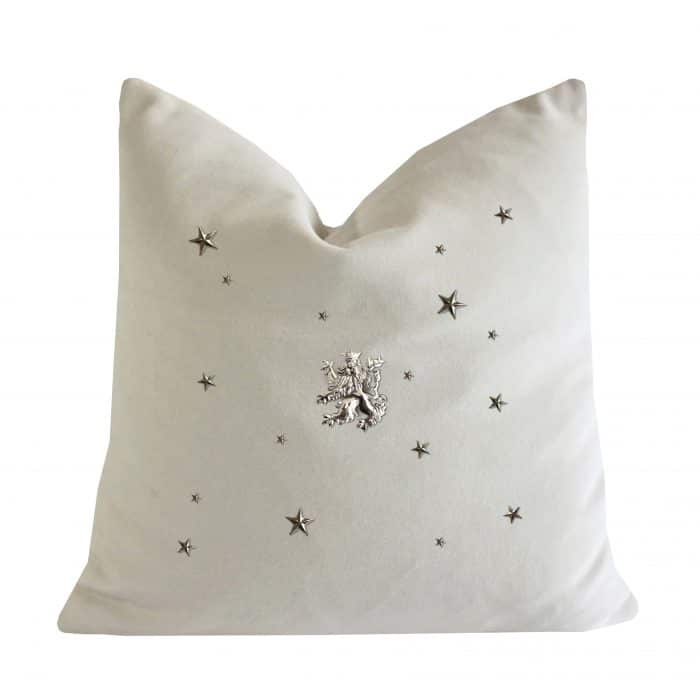Bone cushion with silver rampant lion and stars.